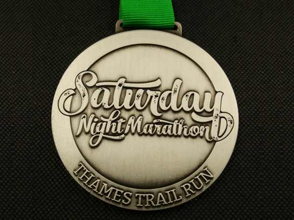 saturday-night-marathon-medal-600x450